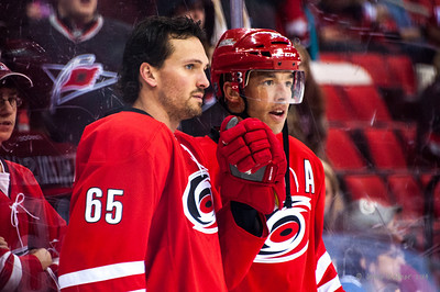 Ron Hainsey and Manny Malhotra. February 8, 2014. Carolina Hurricanes vs. Montreal Canadiens, PNC Arena, Raleigh, NC.  Copyright © 2014 Jamie Kellner. All Rights Reserved.