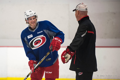 Elias Lindholm chats with John MacLean. October 23, 2013. Carolina Hurricanes practice at Raleigh Center Ice, Raleigh, NC.  Copyright © 2013 Jamie Kellner. All rights reserved.